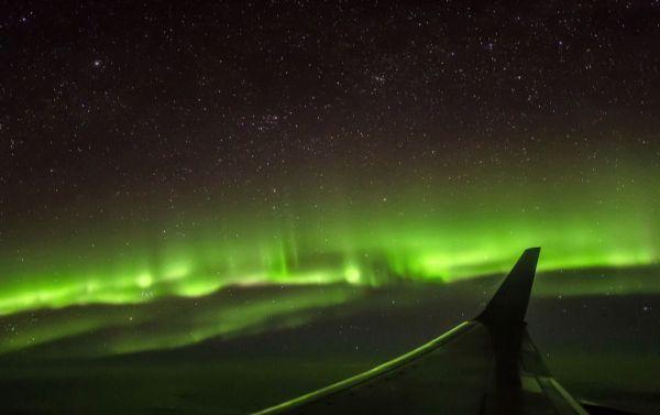 Polarlichter gesehen aus der Kabine einer TuiFly-Boeing 737-800